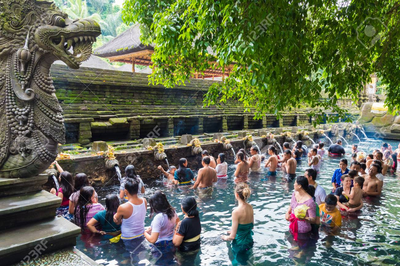 Bali, Indonesia - May 1, 2017: Tirta Empul Temple is a Hindu Balinese water temple famous for its holy spring water, where Balinese Hindus go for ritual purification near Tampaksiring, Bali, Indonesia